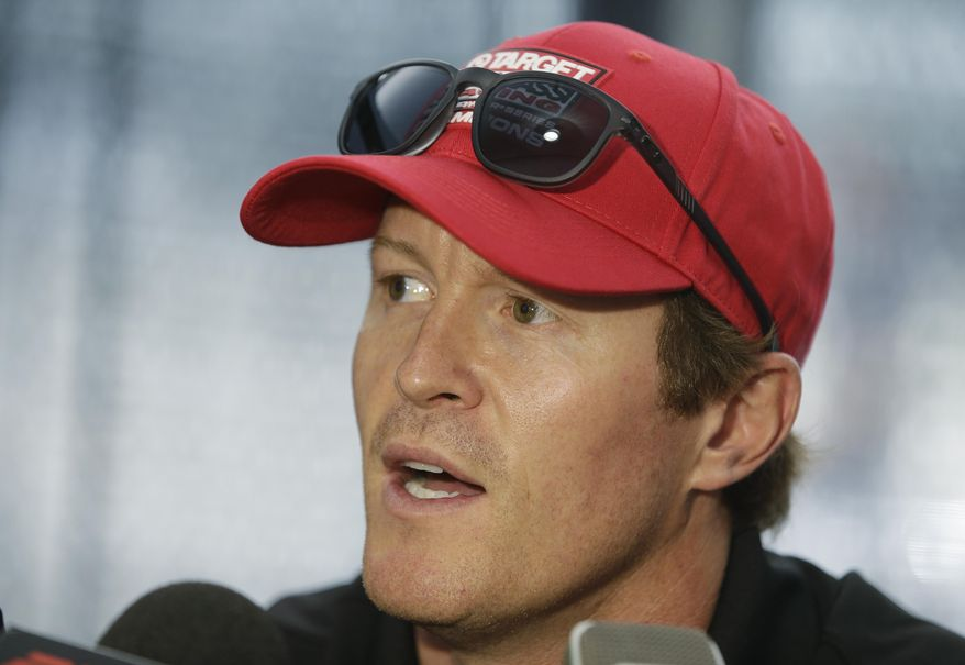 Scott Dixon, of New Zealand, responds to a question during a media interview for the Indianapolis 500 IndyCar auto race at the Indianapolis Motor Speedway in Indianapolis, Thursday, May 22, 2014. (AP Photo/Darron Cummings)