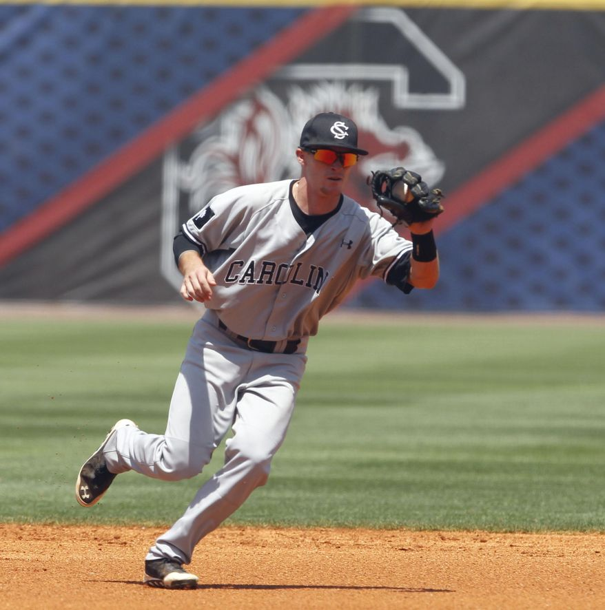South Carolina's Marcus Mooney fields a ground ball during the first inning against Florida at the Southeastern Conference NCAA college baseball tournament on Thursday, May 22, 2014, in Hoover, Ala. (AP Photo/Butch Dill)