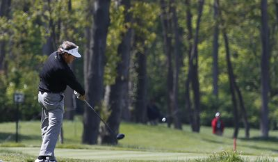 Joey Sindelar hits his tee shot on the 10th hole in the first round of the 75th Senior PGA Championship golf tournament at the Harbor Shores Golf Club during a news conference in Benton Harbor, Mich., Thursday, May 22, 2014.  (AP Photo/Paul Sancya)