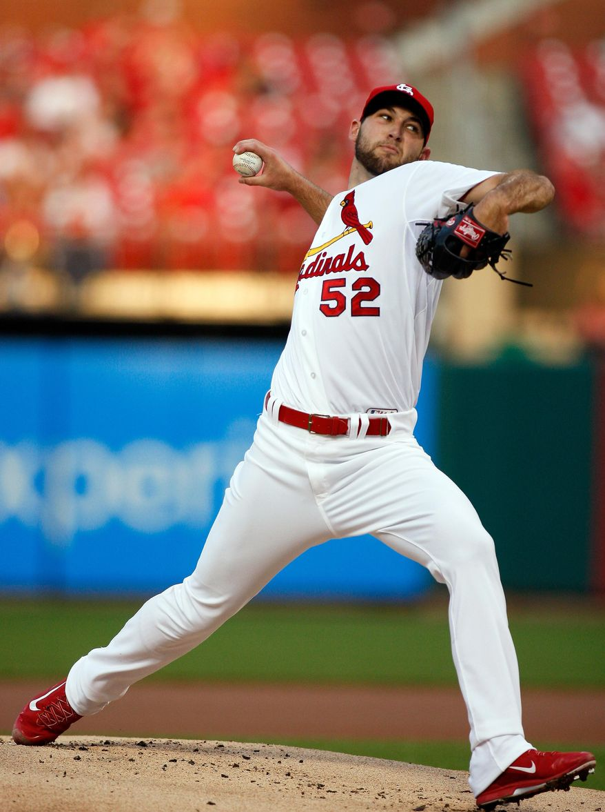 St. Louis Cardinals starting pitcher Michael Wacha throws during the first inning of a baseball game against the Arizona Diamondbacks on Wednesday, May 21, 2014, in St. Louis. (AP Photo/Scott Kane)