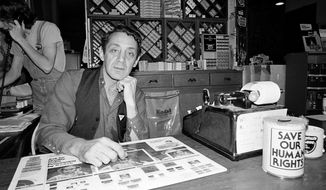 This June 28, 1977, file photo shows gay activist and political leader Harvey Milk in his camera store in San Francisco. (AP Photo, File)
