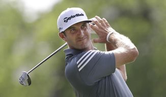 Dustin Johnson watches his tee shot on the 18th hole during the first round of the PGA Colonial golf tournament in Fort Worth, Texas, Thursday, May 22, 2014. (AP Photo/LM Otero)