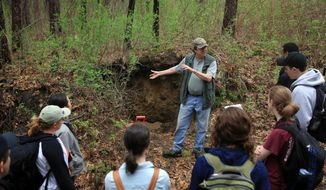 In a Tuesday, May 20, 2014 photo, Jay Bell, Associate Dean at the University of Minnesota College of Food, Agricultural and Natural Resource Sciences, introduces his students to a soil pit research area in Vadnais Heights, Minn. Bell, a soil science professor at the university, wants you to know this isn't just dirt. It holds great beauty (AP Photo/MPR News,Jeffrey Thompson)