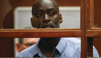 "Actor Michael Jace appears in court in Los Angeles Thursday, May. 22, 2014.  A judge has delayed the arraignment of  Jace on a murder charge filed over his wife's shooting death earlier this week. Attorneys for Jace, who played a police officer in the hit TV series ""The Shield,"" sought a continuance during the actor's first court appearance in Los Angeles on Thursday. He's due back in court June 18. The 51-year-old was charged Thursday with a single count of murder and he is accused of shooting his wife April multiple times in their home Monday evening. (AP Photo/David McNew, Pool)"