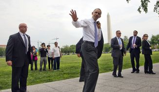 ** FILE ** President Barack Obama waves to tourists during his surprise walk along the Ellipse in Washington, Wednesday, May 21, 2014. Obama walked to the Department of the Interior to sign a proclamation regarding the Organ Mountains-Desert Peaks National Monument. (AP Photo/Pablo Martinez Monsivais)