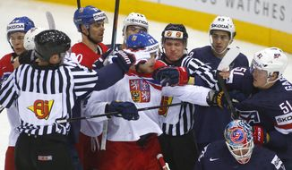 Czech Republic's and USA players scuffle during the Group A Quarterfinal match at the Ice Hockey World Championship in Minsk, Belarus, Thursday, May 22, 2014. (AP Photo/Sergei Grits)