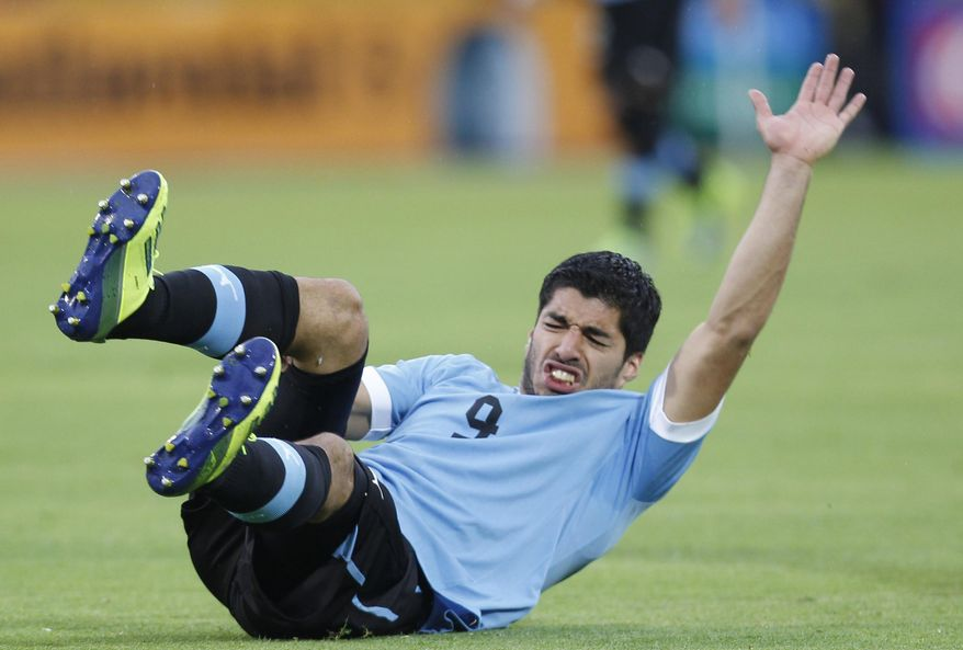 FILE - This is a Friday, Oct. 11, 2013 file photo of Uruguay's Luis Suarez, as he reacts after falling during a 2014 World Cup qualifying soccer game against Ecuador in Quito, Ecuador. Uruguay striker Luis Suarez has undergone keyhole surgery on his knee and is expected to recover in time for the World Cup. The mother of the 27-year-old Liverpool striker says he had surgery Thursday May 22, 2014 to repair damage to his meniscus. Sandra Diaz tells The Associated Press that the surgery was successful and that he is expected to recover in 2-3 weeks. Uruguay plays its first match at the World Cup against Costa Rica on June 14. The team will then face England on June 19 and Italy on June 24. (AP Photo/Martin Mejia, File)