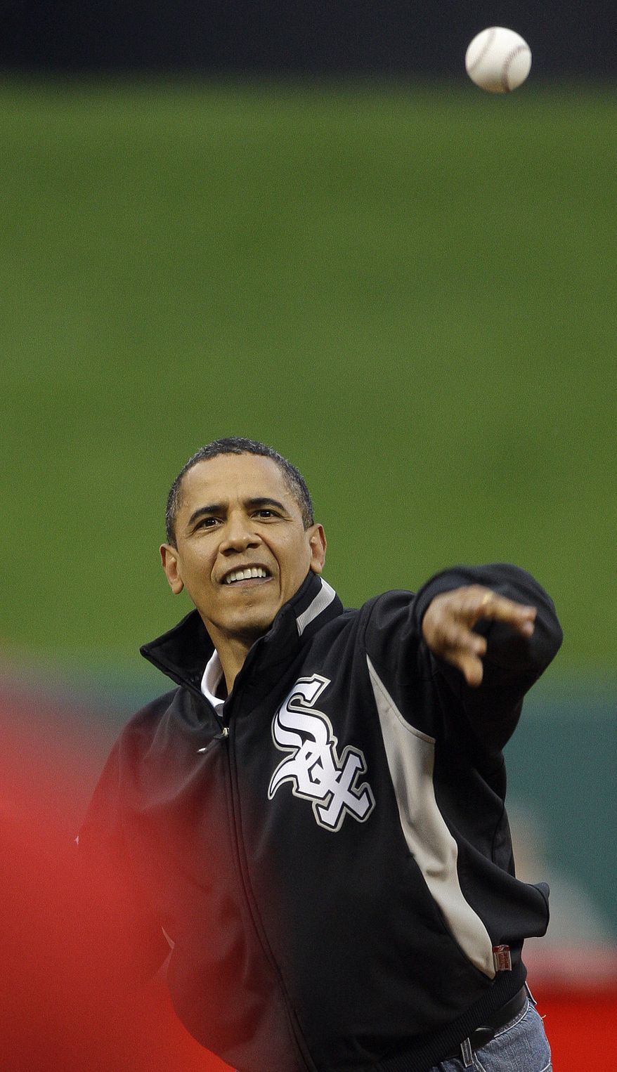 President Barack Obama throws out the ceremonial first pitch during the first inning of the MLB All-Star baseball game in St. Louis, Tuesday, July 14, 2009. (AP Photo/Morry Gash)