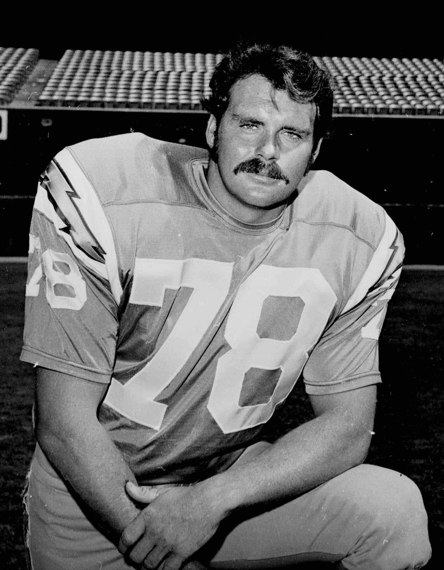 File-This September 1970 file photo of San Diego Chargers guard Walt Sweeney. Sweeney, a standout offensive lineman for the San Diego Chargers in the 1960s and 1970s, has died at 71. The Chargers website says Sweeney died of pancreatic cancer on Saturday Feb. 2,2013. (AP Photo,File)