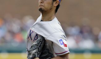 Texas Rangers starting pitcher Yu Darvish throws during the first inning of a baseball game against the Detroit Tigers in Detroit, Thursday, May 22, 2014. (AP Photo/Carlos Osorio)