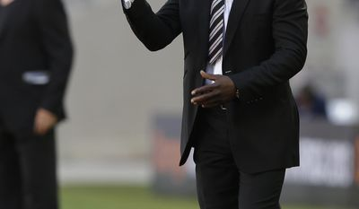 FILE - In this Jan. 20, 2013, file photo, Ghana's head coach Kwesi Appiah calls to his players from the sidelines during Ghana's African Cup of Nations Group B soccer match against Congo at Nelson Mandela Bay Stadium in Port Elizabeth, South Africa. (AP Photo/Rebecca Blackwell,File) - SEE FURTHER WORLD CUP CONTENT AT APIMAGES.COM