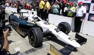 Ed Carpenter pulls in after winning the pole during qualifications for the Indianapolis 500 IndyCar auto race at the Indianapolis Motor Speedway in Indianapolis, Sunday, May 18, 2014. (AP Photo/Michael Conroy)