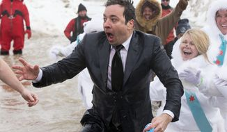 "FILE - In this March 2, 2014 file photo, Jimmy Fallon, host of ""The Tonight Show,"" exits the icy waters of Lake Michigan during the ""Polar Plunge"" in Chicago. Fallon was joined Chicago Mayor Rahm Emanuel in the event. Emanuel will now appear on ""The Tonight Show"" with Jimmy Fallon on June 3, making good on his promise after Fallon came to participate in the event. (AP Photo/Andrew A. Nelles, File)"