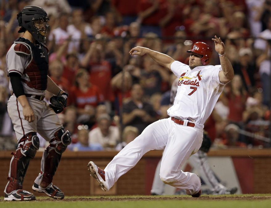 St. Louis Cardinals' Matt Holliday scores on a double by Allen Craig as Arizona Diamondbacks catcher Tuffy Gosewisch stands by during the seventh inning of a baseball game Thursday, May 22, 2014, in St. Louis. (AP Photo/Jeff Roberson)