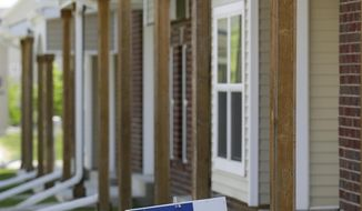 A sign sits in front of a townhomes for sale, Wednesday, May 21, 2014, in West Des Moines, Iowa. All-cash home sales have more than doubled in the past year, increasing from 19.1 percent of all home sales nationwide in the first quarter of 2013 to 42.7 percent in the first quarter this year, according to data released this month by RealtyTrac, a real estate research firm. (AP Photo/Charlie Neibergall)