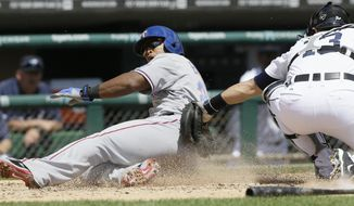 Texas Rangers' Adrian Beltre beats the tag of Detroit Tigers catcher Alex Avila during the third inning of a baseball game in Detroit, Thursday, May 22, 2014. (AP Photo/Carlos Osorio)