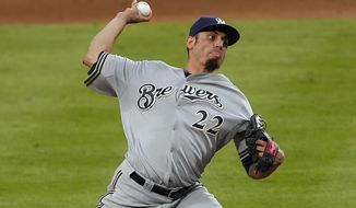 Milwaukee Brewers starting pitcher Matt Garza works in the fourth inning of a baseball game against Atlanta Braves Thursday, May 22, 2014, in Atlanta. (AP Photo/John Bazemore)