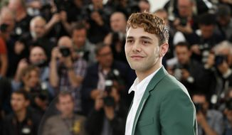 Director Xavier Dolan poses during a photo call for Mommy at the 67th international film festival, Cannes, southern France, Thursday, May 22, 2014. (AP Photo/Alastair Grant)