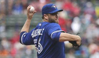 Toronto Blue Jays starting pitcher Mark Buehrle delivers to the Boston Red Sox during the first inning of a baseball game at Fenway Park, Thursday, May 22, 2014, in Boston. (AP Photo/Charles Krupa)