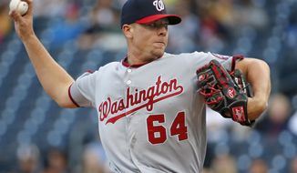 Washington Nationals starting pitcher Blake Treinen delivers during the first inning of a baseball game against the Pittsburgh Pirates in Pittsburgh on Thursday, May 22, 2014. (AP Photo/Gene J. Puskar)