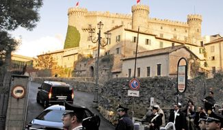 """FILE  - In this Nov. 18, 2006 file photo, a dark van followed by a limousine arrives at the Orsini Odescalchi castle in the lakeside town of Bracciano, some 43 kilometers (27 miles) from Rome where U.S. actor Tom Cruise will wed actress Katie Holmes. As Romeo said: """"My bounty is as boundless as the sea ... the more I give to thee, the more I have."""" His modern-day counterparts _ the kind with deep pockets _ are going all out to offer extravagant, star-studded weddings to their own Juliets. (AP Photo/Riccardo De Luca, File)"""
