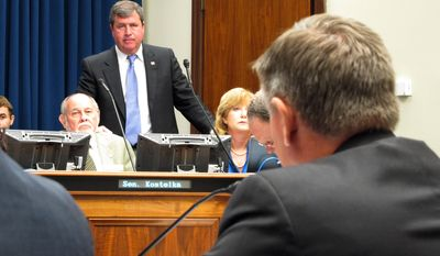 Sen. Neil Riser, R-Columbia, standing, and Sen. Bob Kostelka, R-Monroe, seated, listen to debate on a bill changing how workers compensation benefits are calculated for professional athletes, Thursday, May 22, 2014, in Baton Rouge, La. The Senate labor committee narrowly voted to advance the bill pushed by New Orleans Saints NFL football team owner Tom Benson. (AP Photo/Melinda Deslatte)