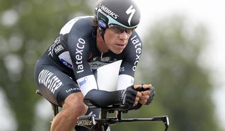 Colombia's Rigoberto Uran pedals to win the 12th stage of the Giro d'Italia, Tour of Italy cycling race, from Barbaresco to Barolo, Italy, Thursday, May 22, 2014, and take the overall lead in the race.  The Colombian had been 57 seconds behind Cadel Evans but won the 42-kilometer (26-mile) individual time trial from Barbaresco to Barolo in 57 minutes, 34 seconds. (AP Photo/Fabio Ferrari)