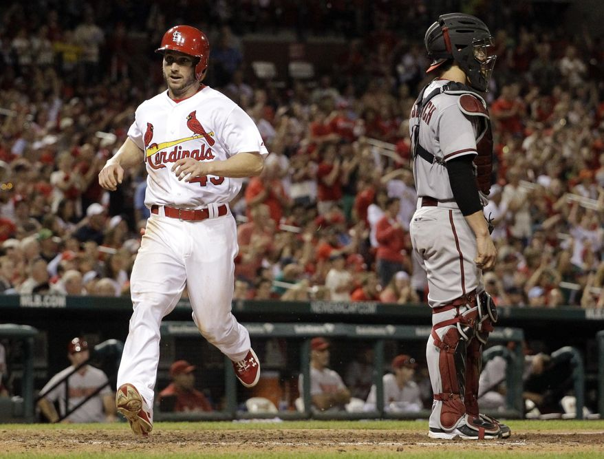 St. Louis Cardinals' Shane Robinson, left, scores on a single by Matt Carpenter as Arizona Diamondbacks catcher Tuffy Gosewisch stands by during the eighth inning of a baseball game Thursday, May 22, 2014, in St. Louis. (AP Photo/Jeff Roberson)