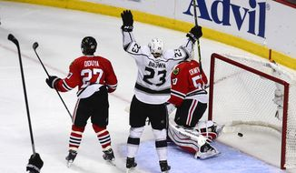 Los Angeles Kings Dustin Brown signals goal after his teammate Jake Muzzin scored in the third period during Game 2 of the Western Conference finals in the NHL hockey Stanley Cup playoffs Wednesday, May 21, 2014, in Chicago. The Kings won 6-2. (AP Photo/Daily Herald,  Mark Welsh)