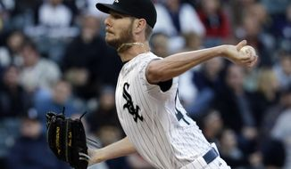 Chicago White Sox  starter Chris Sale throws against the New York Yankees during the first inning of a baseball game in Chicago on Thursday, May 22, 2014. (AP Photo/Nam Y. Huh)