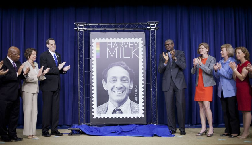 Deputy Postmaster General Ronald A. Stroman, fourth from right, and others, applaud during the unveiling ceremony of the Harvey Milk Forever Stamp in the South Court Auditorium of the Eisenhower Executive Office Building on the White House complex in Washingotn, Thursday, May 22, 2014. Joining Stroman, from left are, Rep. John Lewis, D-Ga., House Minority Leader Nancy Pelosi of Calif., Stuart Milk, Founder and President, Harvey Milk Foundation, Ambassador UN Ambassador Samantha Power, Sen. Tammy Baldwin, D-Wis., and Rep. Debbie Wasserman Schultz, D-Fla. On the day he would have turned 84 years old, Harvey Milk, the San Francisco supervisor and gay activist gunned down at City Hall in 1978, had a postal stamp in his honor unveiled at the White House today. (AP Photo/Pablo Martinez Monsivais)