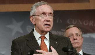 Senate Majority Leader Harry Reid of Nev., left, accompanied by Senate Majority Whip Richard Durbin of Ill., speak to reporters on Capitol Hill in Washington, Thursday, May 22, 2014, to discuss immigration reform.  (AP Photo/Lauren Victoria Burke)
