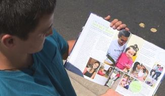 Mesa High School senior Gregory Gomez shows a section of his yearbook highlighting teen parents. (Krystle Henderson/12 News/AZCentral)