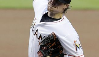 Miami Marlins' Tom Koehler pitches against the Milwaukee Brewers in the first inning of a baseball game in Miami, Friday, May 23, 2014. (AP Photo/Alan Diaz)