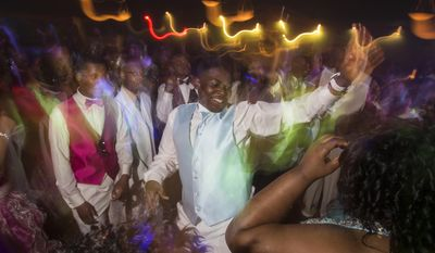 Students dance during the Saginaw High School prom, Thursday, May 22, 2014 at the Candlelite Banquet Center in Bridgeport Township.  (AP Photo/The Saginaw News, Tim Goessman)