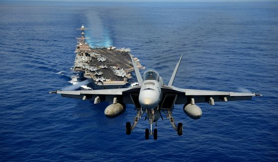An F/A-18E Super Hornet from the Tophatters of Strike Fighter Squadron (VFA) 14 participates in an air power demonstration over the aircraft carrier USS John C. Stennis (CVN 74) in the Pacific Ocean, April 24, 2013. (U.S. Navy Photo by Mass Communication Specialist Seaman Apprentice Ignacio D. Perez/Released) ** FILE **