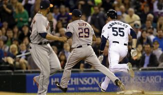 Seattle Mariners' Michael Saunders (55) is safe at first base with a two-run single just ahead of Houston Astros relief pitcher Tony Sipp's (29) force attempt, Thursday, May 22, 2014, in the seventh inning of a baseball game in Seattle. (AP Photo/Ted S. Warren)
