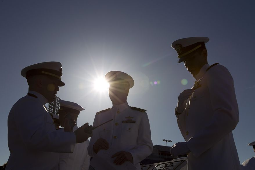 Graduating U.S. Naval Academy Midshipmen arrive at the Academy's graduation and commissioning ceremonies, at Navy-Marine Corps Stadium in Annapolis Md., Friday, May 23, 2014. (AP Photo/Jose Luis Magana)