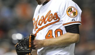 Baltimore Orioles pitcher Troy Patton walks to the dugout after giving up the go-ahead runs to the Cleveland Indians in the 13th inning of a baseball game, Thursday, May 22, 2014, in Baltimore. The Indians won 8-7 in 13 innings. (AP Photo/Gail Burton)