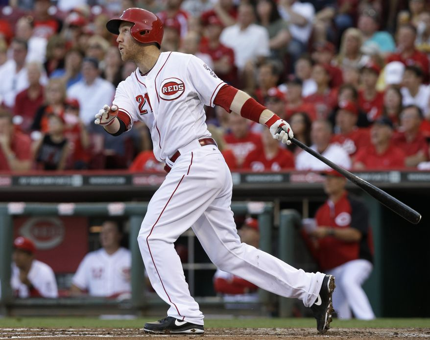 Cincinnati Reds' Todd Frazier follows through on a three-run home run off St. Louis Cardinals starting pitcher Shelby Miller in the third inning of a baseball game, Friday, May 23, 2014, in Cincinnati. (AP Photo/Al Behrman)