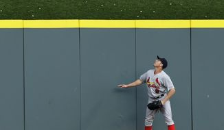St. Louis Cardinals' Peter Bourjos watches a three-run home run hit by Cincinnati Reds' Todd Frazier in the third inning of a baseball game, Friday, May 23, 2014, in Cincinnati. (AP Photo/Al Behrman)