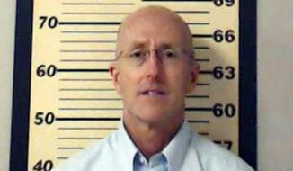 ** FILE ** This photo released Thursday, May 22, 2014, by the Madison Police Department, shows attorney Mark Mayfield.(AP Photo/Madison Police Department)