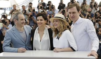 From left, director Olivier Assayas, actress Juliette Binoche, actress Chloe Grace Moretz, and actor Lars Eidinger pose for photographers during a photo call for Sils Maria at the 67th international film festival, Cannes, southern France, Friday, May 23, 2014. (AP Photo/Thibault Camus)