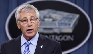 ** FILE ** In this May 1, 2014, file photo, Defense Secretary Chuck Hagel speaks to reporters at the Pentagon. (AP Photo/Manuel Balce Ceneta)