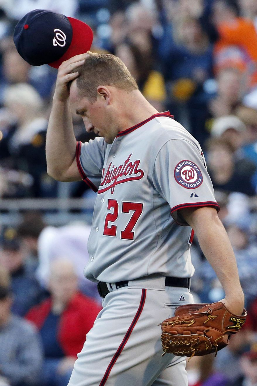 Washington Nationals starting pitcher Jordan Zimmermann walks back to the mound after allowing a run to score from third on a wild pitch during the second inning of a baseball game against the Pittsburgh Pirates in Pittsburgh, Friday, May 23, 2014. (AP Photo/Gene J. Puskar)