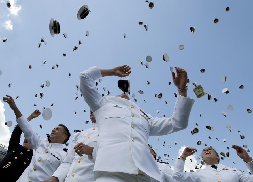 Graduating U.S. Naval Academy Midshipmen throw their hats into the air during the United States Naval Academy 2014 Class graduation and commissioning ceremonies at Navy-Marine Corps Stadium in Annapolis, Md., Friday May 23, 2014. (AP Photo/Jose Luis Magana)