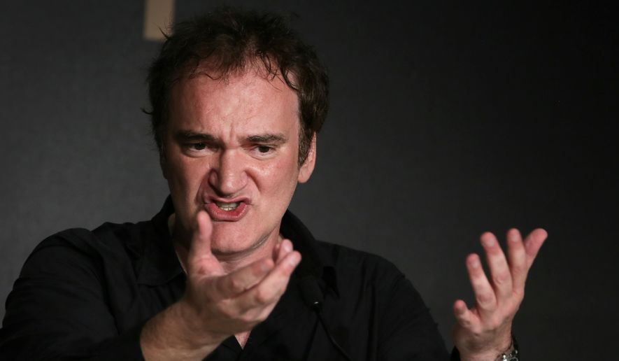 Director Quentin Tarantino speaks during a press conference at the 67th international film festival, Cannes, southern France, Friday, May 23, 2014. (AP Photo/Virginia Mayo) ** FILE **