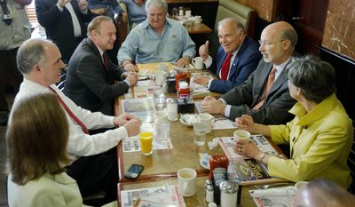 """Seated clockwise from left, former state Environmental Protection Secretary Katie McGinty, Sen. Bob Casey, D-Pa., State Treasurer Rob McCord, U.S. Rep. Bob Brady, D-Pa., former Pennsylvania Gov. Ed Rendell, Pennsylvania Democratic gubernatorial nominee Tom Wolf, and U.S. Rep. Allyson Schwartz, D-Pa., sit down for a meal at the Oregon Diner, Friday, May 23, 2014, in Philadelphia. The group gathered in what Brady billed as a """"unity"""" breakfast with the three candidates, McCord, McGinty, and Schwartz, Wolf defeated in the primary election after the campaign turned particularly nasty in the last six weeks. (AP Photo/Matt Rourke)"""