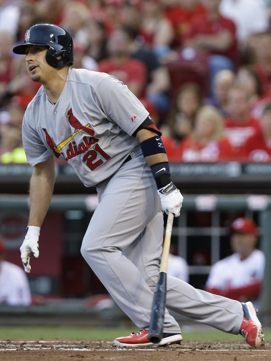 St. Louis Cardinals' Allen Craig watches his two-run hit off Cincinnati Reds starting pitcher Homer Bailey in the fourth inning of a baseball game, Friday, May 23, 2014, in Cincinnati. (AP Photo/Al Behrman)