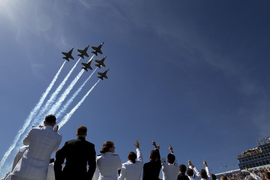 U.S. Navy flight demonstration team, The Blue Angels perform a flyover above graduating Midshipmen during the United States Naval Academy 2014 Class graduation and commissioning ceremonies at Navy-Marine Corps Stadium in Annapolis, Md., Friday May 23, 2014. (AP Photo/Jose Luis Magana)